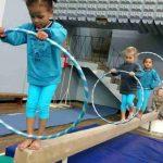 Wynland Gymnastics kidi-gym-gymnasts-practice-on-bar
